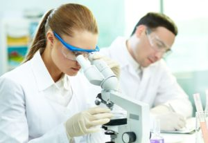 15609670 - serious clinician studying chemical element in laboratory